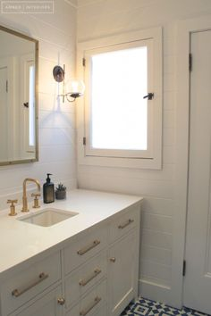 Guest Bathroom Remodel   amber interiors   tongue & groove paneling   tile   modern hardware