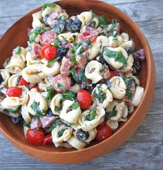 Tortellini Salad: A fresh meal in a bowl! Cheese tortellini, salami, olives, fresh basil and vegetables