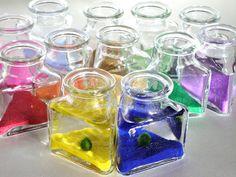 One Pick-Your-Favorite-Color Marimo Moss Ball Aquarium / Aquatic Moss Terrarium. $16.00, via Etsy.