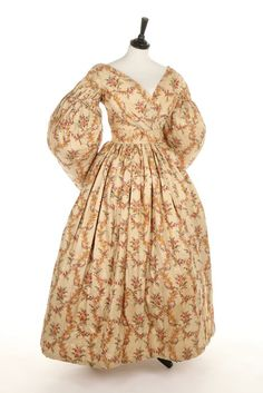 A printed silk dress, circa 1836. with gigot sleeves, pleated mancherons, padded hem, bust approx 81cm, 32in Provenance: The late Harry Matthews collection