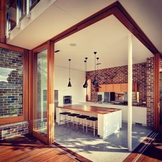 Modern Kitchen Design : A selection of Tom Dixon Beat Lights hang above this stylish kitchen island. Brick Wall Kitchen, Open Kitchen, Nice Kitchen, Glass Kitchen, Kitchen Island, Awesome Kitchen, Beautiful Kitchen, Kitchen Ideas, Kitchen Decor