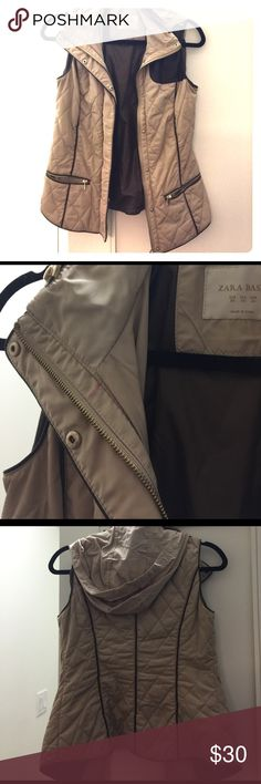 Zara tan/leather puffer vest Tan quilted puffer vest with dark brown leather details. The piping gives you a super flattering fit where you don't feel like a puffball - hard to find in vests like these 😛 best part is it has a little hood and pockets too! Perfect for hiking or just bopping around on the weekends 🤗 teeny lipstick stain on the inside of zipper but can probably get it out. XS/S Zara Jackets & Coats Vests