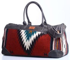 Each OAXACAN DUFFEL BAG is inherently unique bearing such Zapotec weaving that includes natural elements such as berries, moss, tree bark and larvae, giving vibrant colors of reds, greens, browns and yellows.