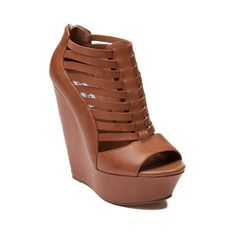 Shop for Womens SHI by Journeys Luna Wedge in Cognac at Journeys Shoes. Shop today for the hottest brands in mens shoes and womens shoes at Journeys.com.Youll be over the moon for the new Luna Wedge from SHI by Journeys! Step into the Luna Wedge boasting a synthetic leather upper with strappy vamp detailing, peep toe, and enclosed heel zipper for easy on-and-off.  Heel Height 5.5 Platform Height 1.75 Available for shipment in September; pre-order yours today!