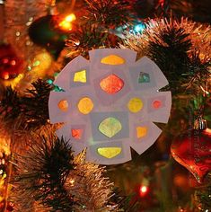 If you're looking for unique and fun Christmas craft ideas for kids, show them this Faux Stained Glass Snowflake Paper Ornament. They will want to make these snowflake decorations right away. In fact, snowflake ornaments are a great family activity. Origami Christmas Ornament, Christmas Ornaments To Make, Christmas Paper, Homemade Christmas, Xmas, Preschool Christmas Crafts, Holiday Crafts, Paper Ornaments, Ornaments Ideas
