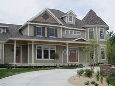 Love the style of this home. I chose this paint color for the exterior of my home-Stone Lion by Sherwin Williams.