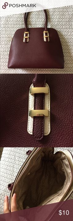 Burgundy and Gold Charming Charlie's Handbag Perfect for fall! Gorgeous burgundy and gold satchel handbag from Charming Charlie's! Excellent condition, barely used. Lots of pockets.    Thanks for shopping my closet! I am happy to provide any measurements you need, and I love accepting offers. Items come from a smoke free home with pets 🐾 Charming Charlie Bags Satchels