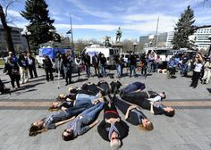 Columbine Massacre:  Thirteen people lay down to symbolize those killed in the Columbine school shooting at a Columbine Remembrance and Rededication on the 10th anniversary of the Columbine attack at the Capitol building in Denver.