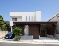 Minimalist Japanese Residence Blends Privacy With An Airy Interior