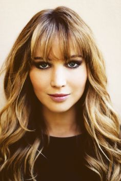 Jennifer Lawrence has beautifully multidimensional brunette waves and eyebrow-grazing bangs. // More hair on #DailyBeauty -- http://bit.ly/znhNjk
