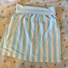 Stretchy high waisted roll over striped skirt Vintage white and blue stretchy skirt. Can be work high waist with a crop top or rolled over lower on the hips. Size medium but stretches to fit a medium/large! Super comfy and great for summer! Brand is jantzen * Lilly Pulitzer Skirts