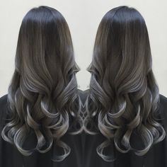 Smoky silver highlights over charcoal black hair color. Artist's credit to come. Long black hair hotonbeauty.com
