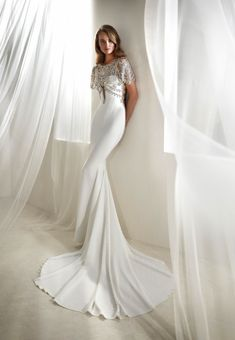 Roca, Atelier Pronovias. Mermaid dress in crepe with beaded bateau neckline. #weddingdress