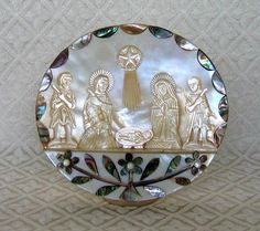 PalestineThis Nativity uses a whole mollusk shell as a background, with hand-carved mother-of-pearl figures