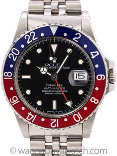 """Rolex GMT ref 16750 Tiffany & Co Spider Dial circa 1985 - Scarce and desirable vintage Rolex GMT ref 16750 8.6 million serial # circa 1985 retailed by Tiffany & Co. Featuring a 39.5mm diameter case with acrylic crystal and red and blue """"Pepsi"""" 24 hour bezel, and beautiful gloss black dial with white gold luminous surrounds and lightly patina'd tritium indexes and matching tritium hands. The rare Tiffany & Co signed black dial also features pronounced and obvious """"spidering"""" associated with…"""