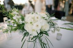 White and green wedding table flowers by Petals & Bliss - Anna Kim Photography