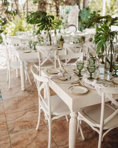 Totally tantalized over this Tropical Baby Shower Brunch by Gretchen Adams of Swoon, out of Harare, Zimbabwe! Featuring a modern gold and white color palette accented with rich tropical greens, this celebration will surely have you mesmerized! So scroll on for a tropical time and be sure to watch for these sweet elements; they're divine:  Gorgeous Green Crystal Goblets Gold-rimmed Plates paired with Gold Flatware Geometric Cookie Favors White Tables lined with White Crossback Chairs Modern Succu