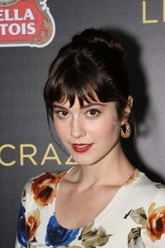 Mary Elizabeth Winstead's Bangin' Updo:   Bangs are bigger than ever, and if you're one of the many who's sporting front fringes, try a style similar to Mary Elizabeth for your next fete. Apply a pea-sized amount of straightening gel, like Redken's Sheer Straight ($16, visit Redken.com for salons), to towel-dried hair. After blow drying, pull all your hair up—except bangs—in a loose ponytail at the crown of your head. Twist the pony and wrap it around itself, securing it with another elastic…