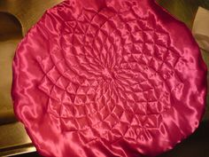 Spiral sewing on satin and padded, This one is giant and so well done! You need driver-lessons to do this.