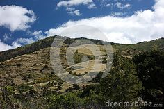 Photo about A view of a rural dirt road in the Sangre De Cristo Mountains in the high arid desert of Colorado. Image of springs, cloudy, desert - 79433530 State Of Colorado, Beautiful Landscapes, Fields, Stock Photos, Mountains, Image, Blood Of Christ, Colors, Bergen