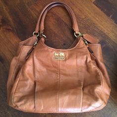 Coach tan leather hobo Gently used condition. Mark on bottom shown in picture. Coach Bags