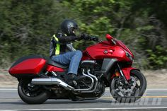 """Okay, gang, drag out your dog-eared glossary of motorcycle terms, thumb through it to the letter """"B,"""" and get ready to do a little editing. Honda, you see, is redefining one of the industry's most established categories: """"baggers."""" For decades, bikes of that sort have been defined by big-inch V-twin cruisers fitted with saddlebags and…"""