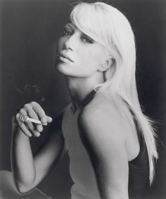 Donatella Versace. How beautiful she was here.  Sorry to say what a victim of plastic surgery she's become.