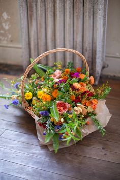 A basket full of flowers! Wildflower bridesmaids bouquets.