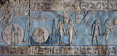 [EGYPT 29589] 'Libra and Virgo on astronomical ceiling at Dendera.'  	Scales and a woman holding an ear of corn portray the zodiac  signs Libra and Virgo on the astronomical ceiling in the outer hypostyle hall of the Hathor Temple at Dendera. The ceiling consists of seven separate strips but here we are looking at a detail of the upper register of the WESTERNMOST STRIP. The scales of Libra are positioned over the hieroglyphic sign for 'horizon' (with a child depicted within the circle of...