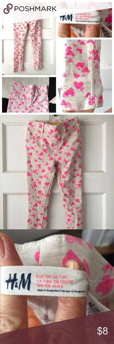 H&M leggings hearts very warm 7-8 Stretchy H&M leggings. Heathered background with pink heart print. Great condition! Bottoms Leggings