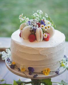 This olive oil cake from Beach Plum Bakery Cafewas frosted with vanilla buttercream, topped with strawberries and macarons, and adorned with fresh blooms.