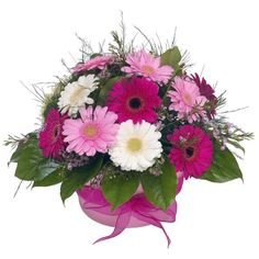 flower arrangements | Flower arrangement of simple pink and white gerberas in a container.