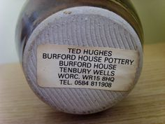 TED HUGHES BURFORD HOUSE POTTERY - label