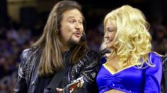Country music artist Travis Tritt and a St. Louis Rams cheerleader perform during the pre-game entertainment segment of Super Bowl XXXIV in Atlanta, Jan. Travis Tritt, Country Music Artists, Soundtrack, St Louis, Cheerleading, Atlanta, Wonder Woman, Entertainment