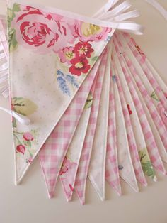 Vintage Tea Time bunting, handmde by Tickety Boo Bunting.  This would look perfect for Alice in Wonderland decor and would go fabulously with our Shabby Chic Country Blue floral bunting too.  A great combination of blues and pinks!