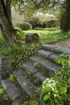 Steps and an old roller in the garden at Godolphin House, in April, near Helston, Cornwall