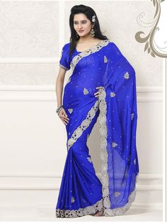 Make yourself look confident and beautiful in this wonderful royal blue saree. The saree is worth collecting for your wardrobe as the saree has an uncommon store work all over it along with border. The gorgeous saree is perfect for  a night party. (Slight variation in color is possible)
