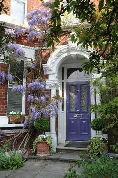 I just love the Wisteria growing up the side of this entrance/doorway and the matching painted door Grand Entrance, Entrance Doors, Doorway, Cool Doors, Unique Doors, Purple Door, Purple Lilac, When One Door Closes, Villa