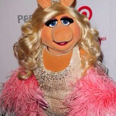 Speaks her mind and has impeccable style...What woman wouldn't want to be like Miss Piggy