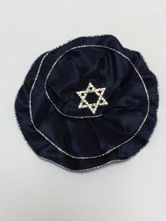 A rhinestone Jewish Star sparkles on a deep Navy Blue Kippah. Beautiful for a Bat Mitzvah Girl or her Mom. Available only on Etsy by VintageBloomsByEllen, $30.00