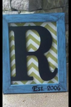 Frame from dollar store, fabric and letter from Hobby Lobby. Spray painted frame and brushed black paint with a sponge to distress the frame. $15