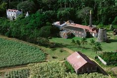 An overhead view of St. Nicholas Abbey, the Barbados sugar cane plantation that inspired Tempest Hall. The house is on the top left, the other buildings are part of the plantation.