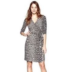 Gap leopard print wrap dress So chic! Gray leopard print wrap dress with 3/4 sleeves. Never been worn, in excellent shape! A perfect dress for a fun date or stroll through town. GAP Dresses Midi