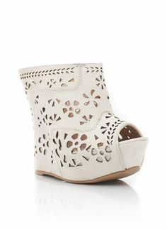 These cut-out wedges are feminine and sweet, and we love the interesting structure. The adorable flower cut-outs will show off a little skin while the peep-toe will show off your pedi.