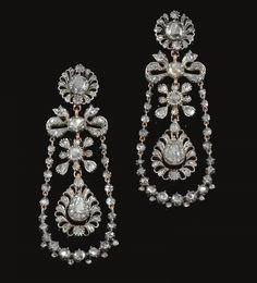 PAIR OF DIAMOND PENDENT EARRINGS, CIRCA 1800 Each of stylised foliate and ribbon design, suspending a chain of rose diamonds in cut down collets and closed back settings, embellished with a swing set to the centre with a pear-shaped rose stone within surrounds of rose diamonds.