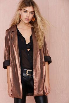 This winter, it's time to kiss basic goodbye.The Donatella Blazer has a metallic bronze exterior and features pockets, 3/4 sleeves, and an oversized fit.