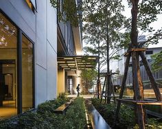 Onyx | Bangkok Thailand | Shma #pool #landscapearchitecture #green #entry #trees #waterfeature #lighting #GardenLighting