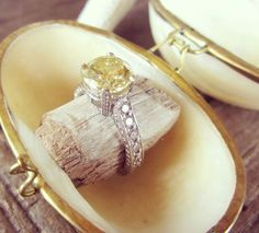 I love the large, round canary diamond. Very unique setting. The diamonds on all sides, very lovely.