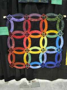 Amish Wedding Ring Quilt by mizuhana, via Flickr.  This one I pinned here for the idea where the 4 rings meet up.