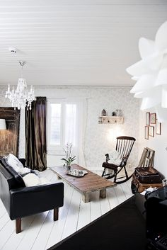 A black and white Finnish log cabin LOVE the coffee table ****